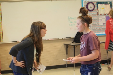 Courtney Deeds (10) and Bailey Chandler (9) practice their lines for the play.