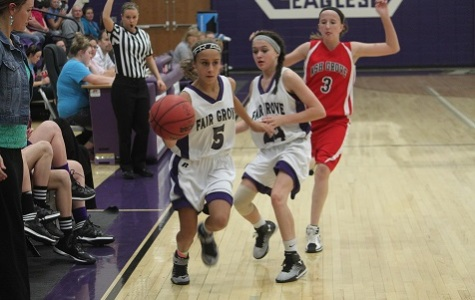 8th grader, Maddie Clark, dribbles the ball down court.