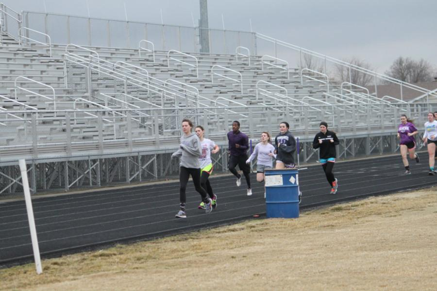Pictured - The Eagles and Lady Eagles running 400's at track practice.