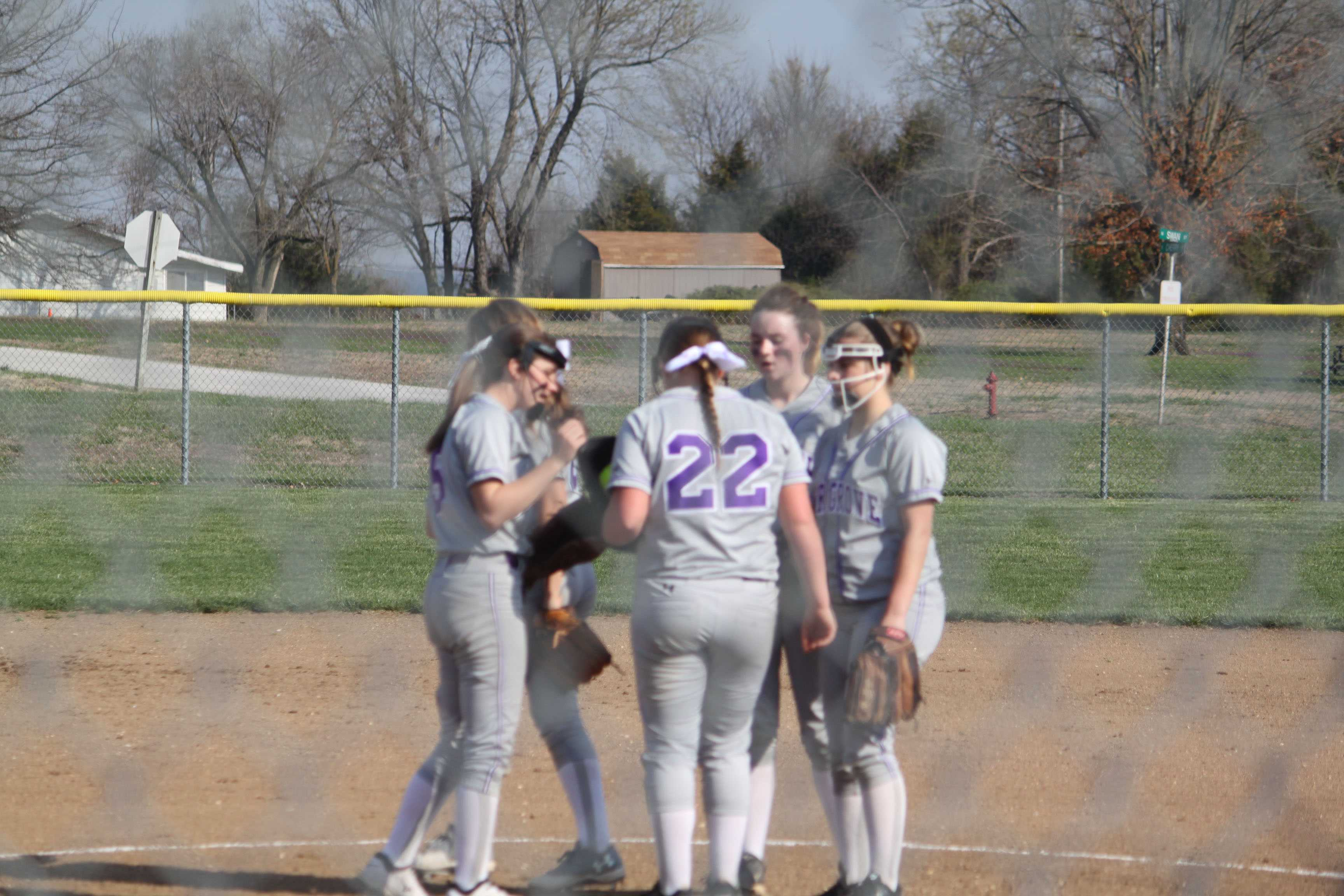 Lady eagles huddle up before taking the field