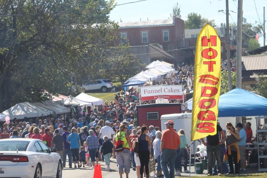 Thousands of people gather at the festival to eat and have fun.