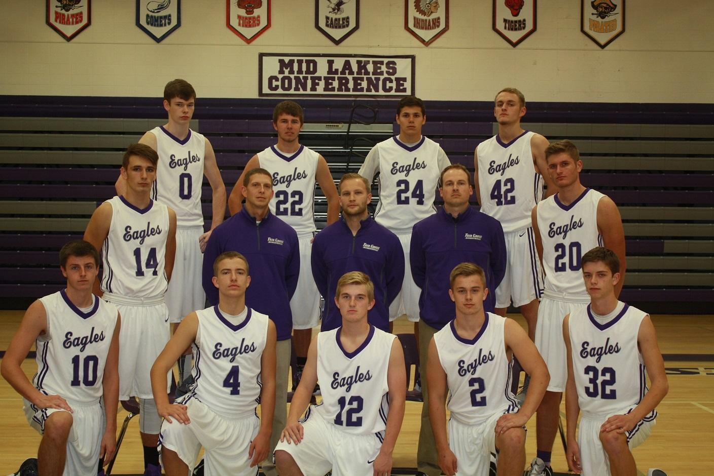 """Fair Grove basketball boys pose for picture on  their """"Media Day"""" in their Throwback Jerseys"""