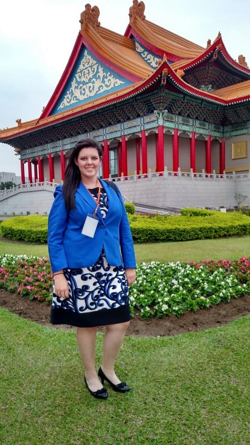 Jessica Cobban stands in front of one of Tiawan's main agricultural buildings.