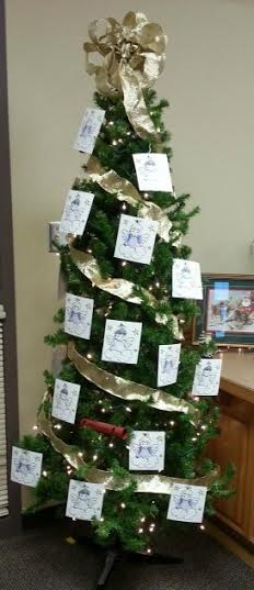 Christmas tree staff members picked names from o adopt families.