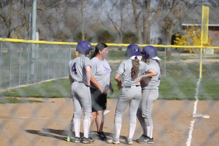 Coach Beckley talks to her players during a break in the action.