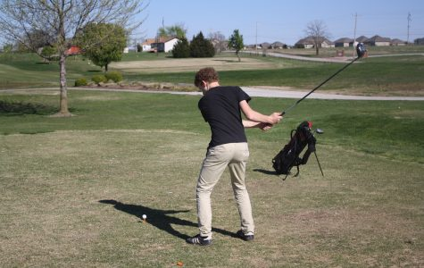 Elias Morelan takes a swing at the ball.