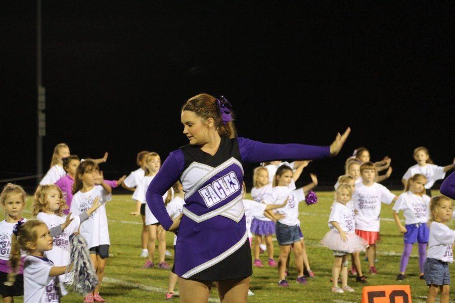 Hannah Mallard, (12), leads the younger cheerleaders in their dance routine.  PHOTO BY ANNA MALLARD