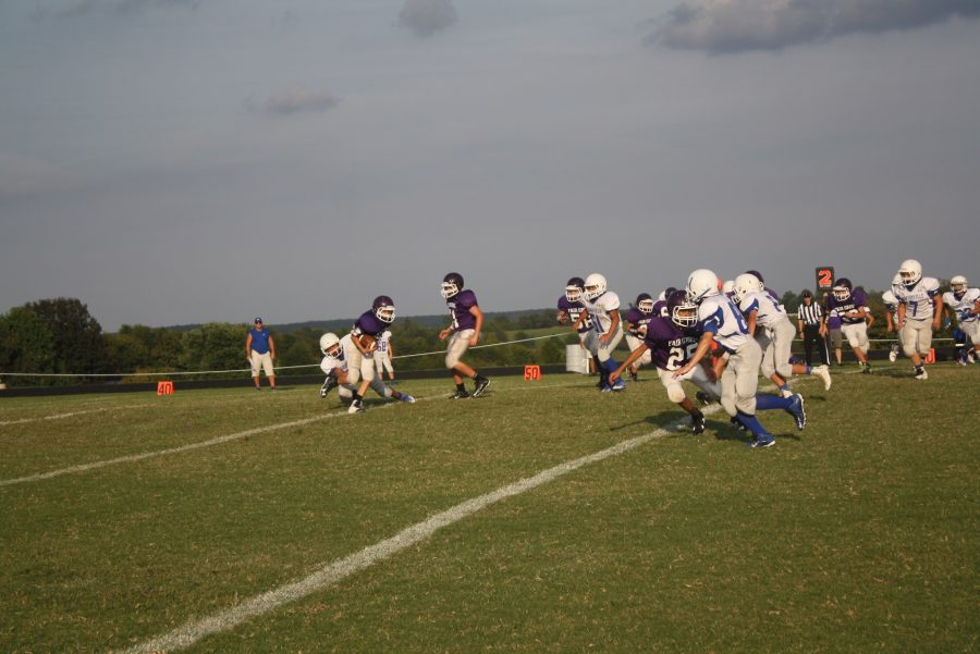 Fair Grove middle school football team attempts to run the ball. PHOTO BY NEWSPAPER STAFF