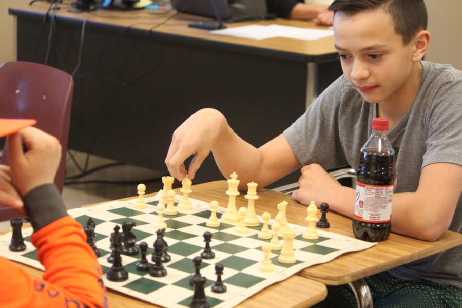 MS student plays against classmate during a chess club meeting.  PHOTO BY BRYSTOL BATES