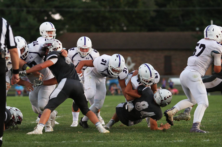 Eagle's Offensive Line clears way for the attack.