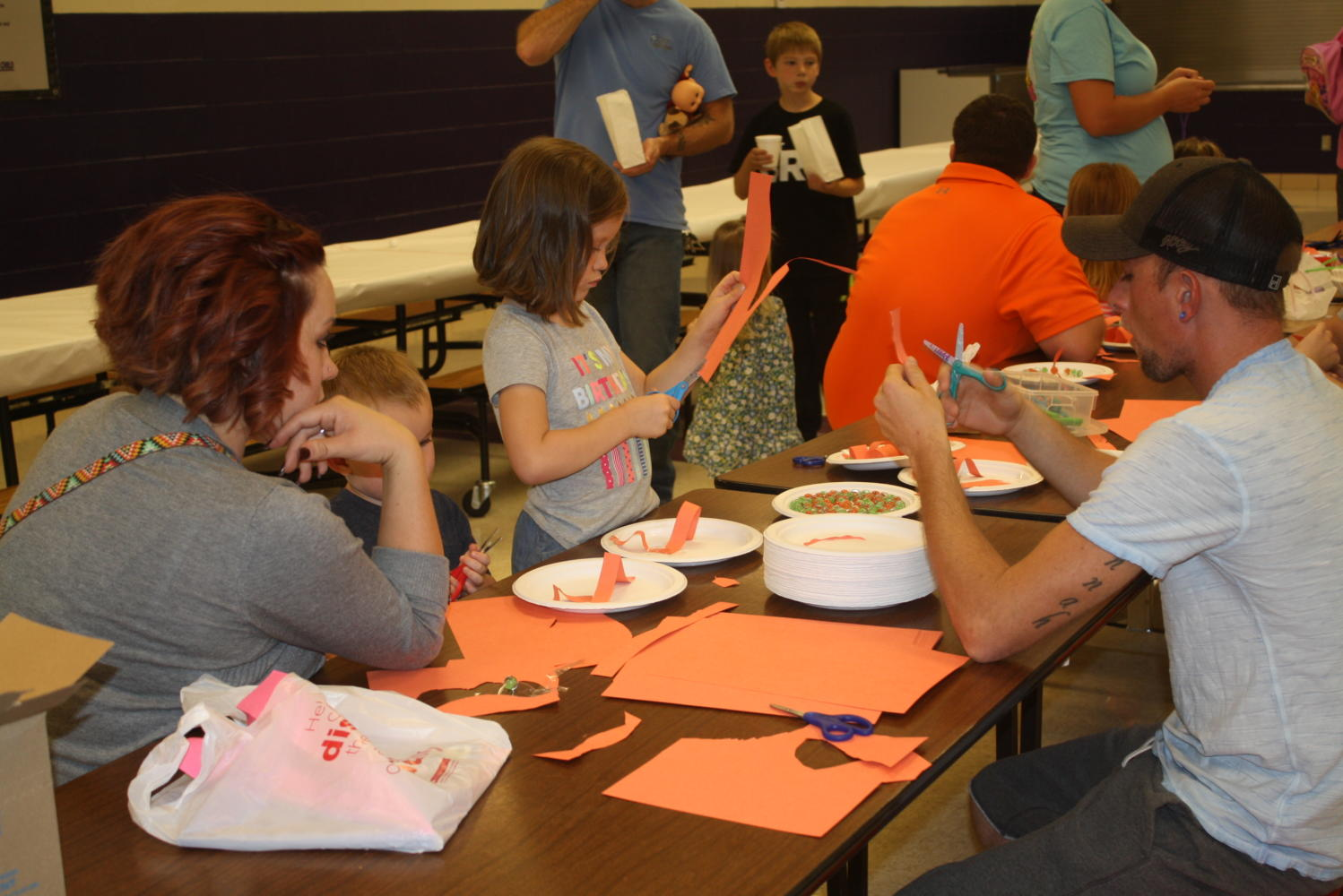 Elementary students enjoy arts and crafts with their grandparents