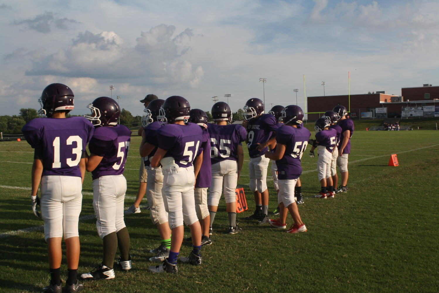 Middle School Football players prepare for practice