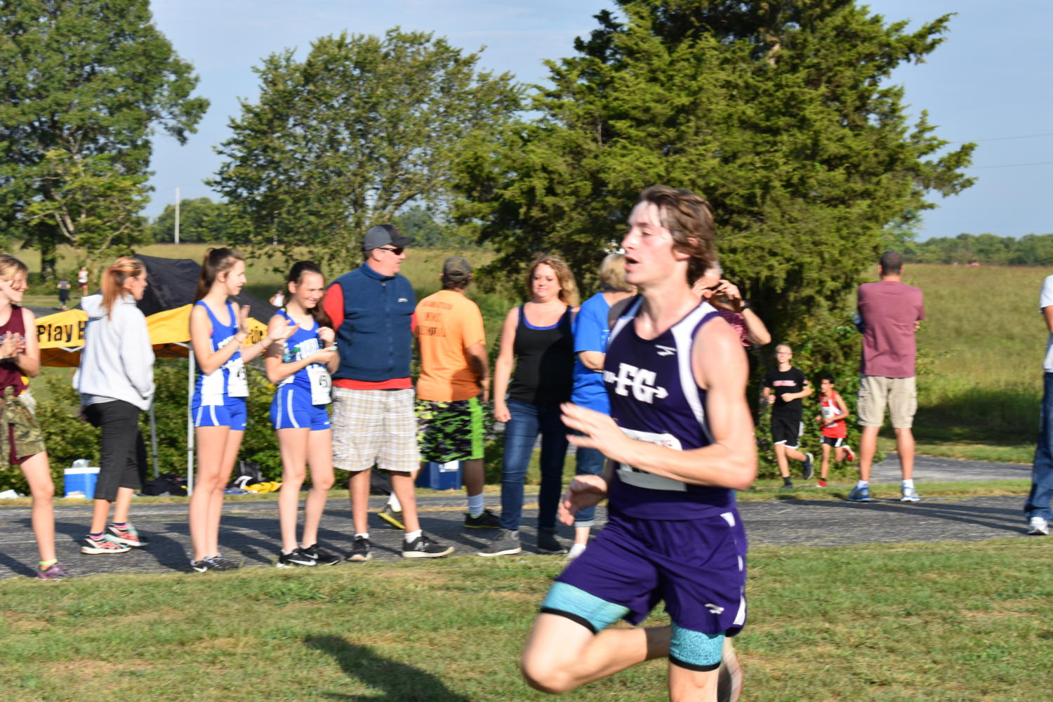 Ryan Odom (11) races to the finish.