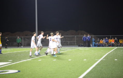 Fair Grove Soccer celebrates after Kyle Stacey scores a goal.