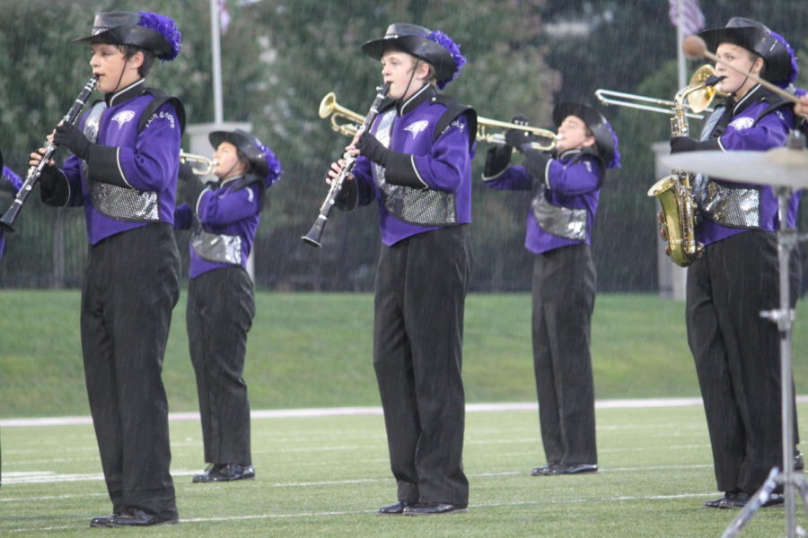 The Fair Grove Band competes during the rainfall.