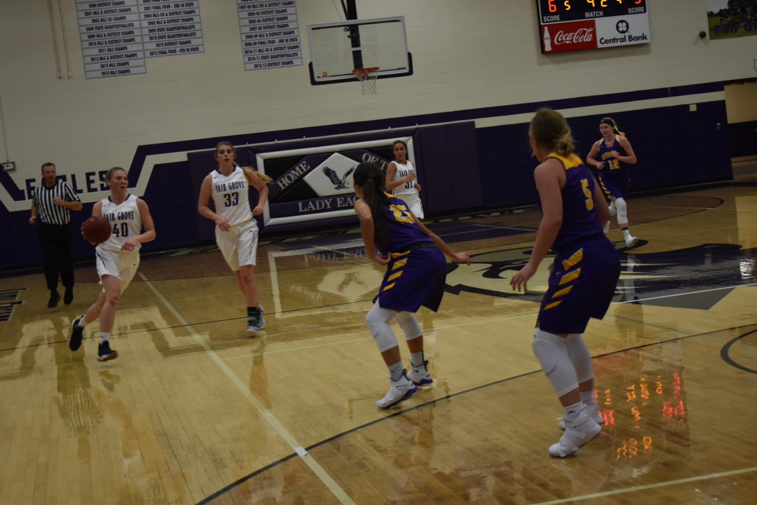 Alana Findley(11) dribbles the ball down the court.