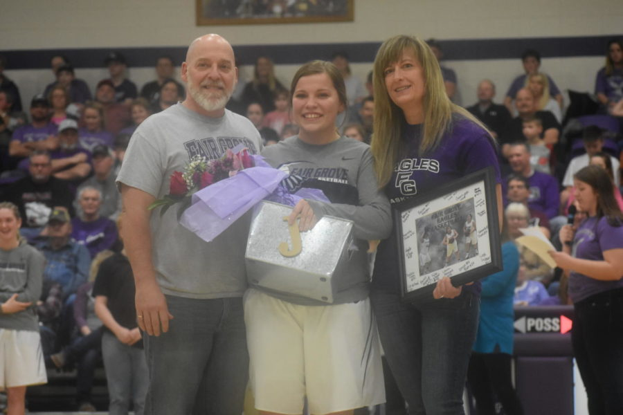 Senior+basketball+player+Jordan+Coddington+with+her+parents+during+senior+night.