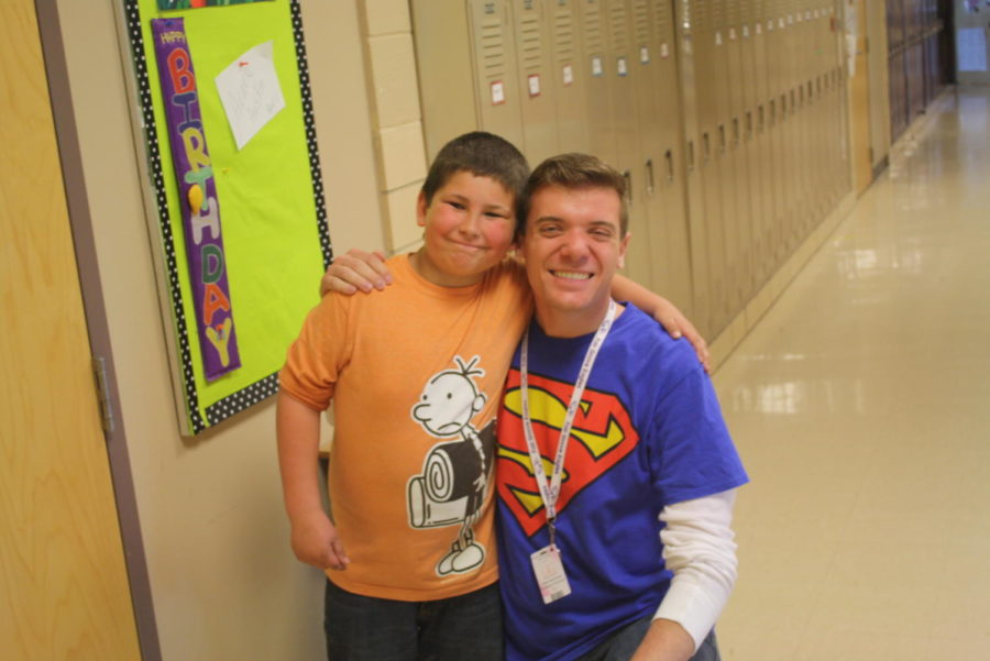 Elementary Counselor,  Jason Bushman, poses with a student