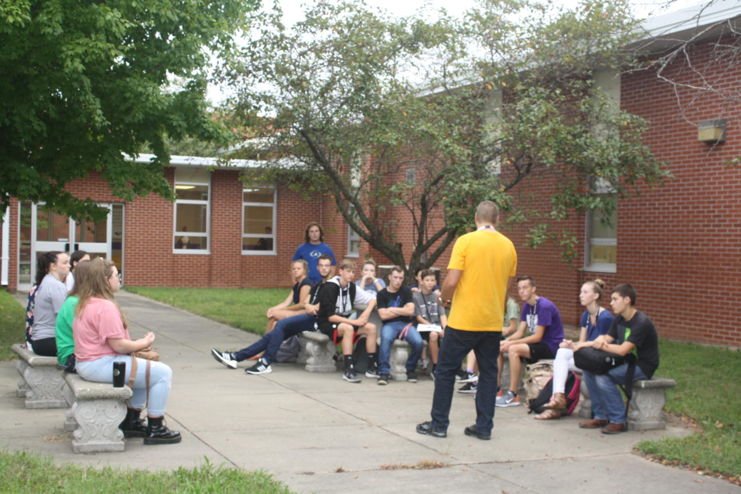 Students meet with Mr. Foster in the courtyard for JOLT