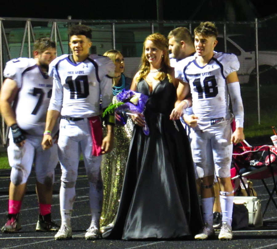 Homecoming+Queen+Kalyn+Wheat+and+her+escorts%2C+Seniors+Elijah+Young+and+Cayden+Stacey%2C+wait+to+be+announced.