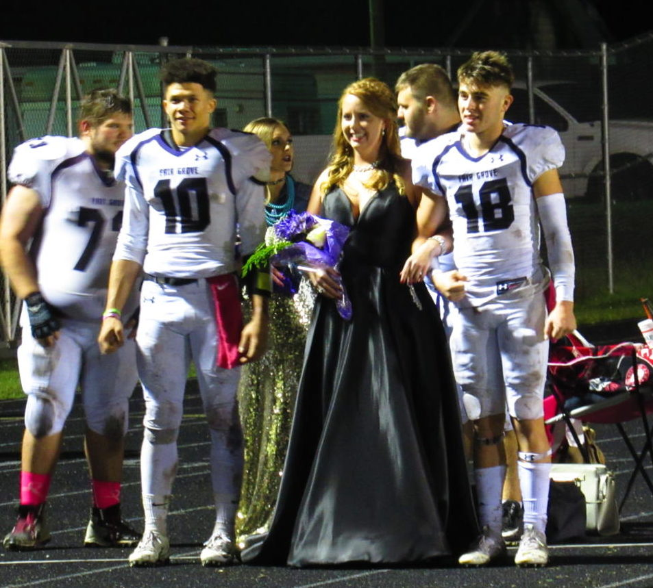 Homecoming Queen Kalyn Wheat and her escorts, Seniors Elijah Young and Cayden Stacey, wait to be announced.