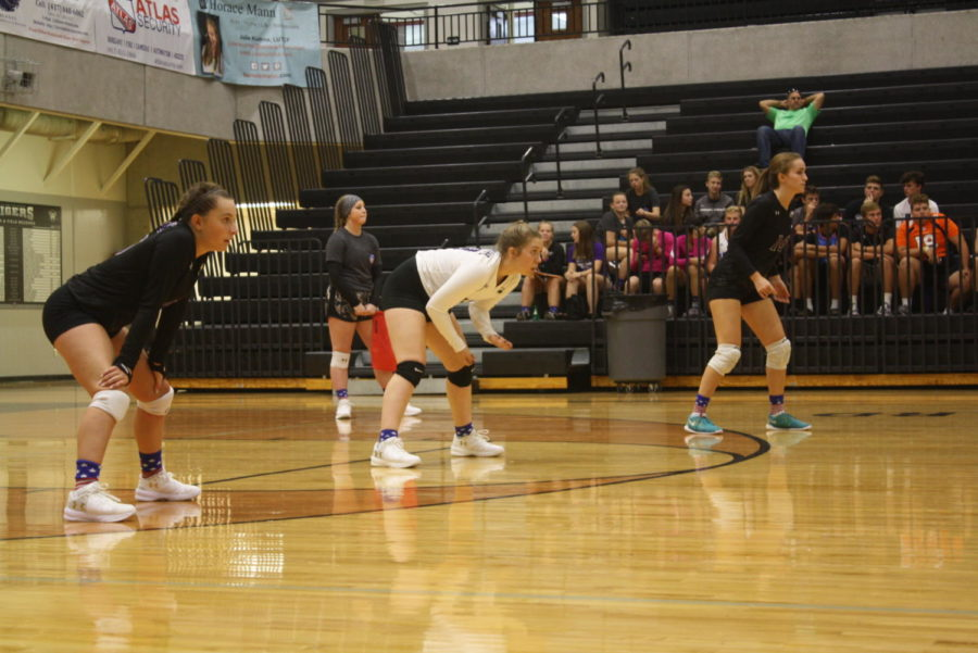 JV+volleyball+defense+prepares+for+serve+receive