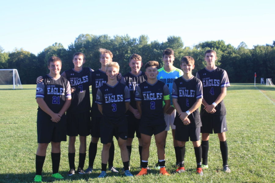 Senior soccer boy players pose for a photo