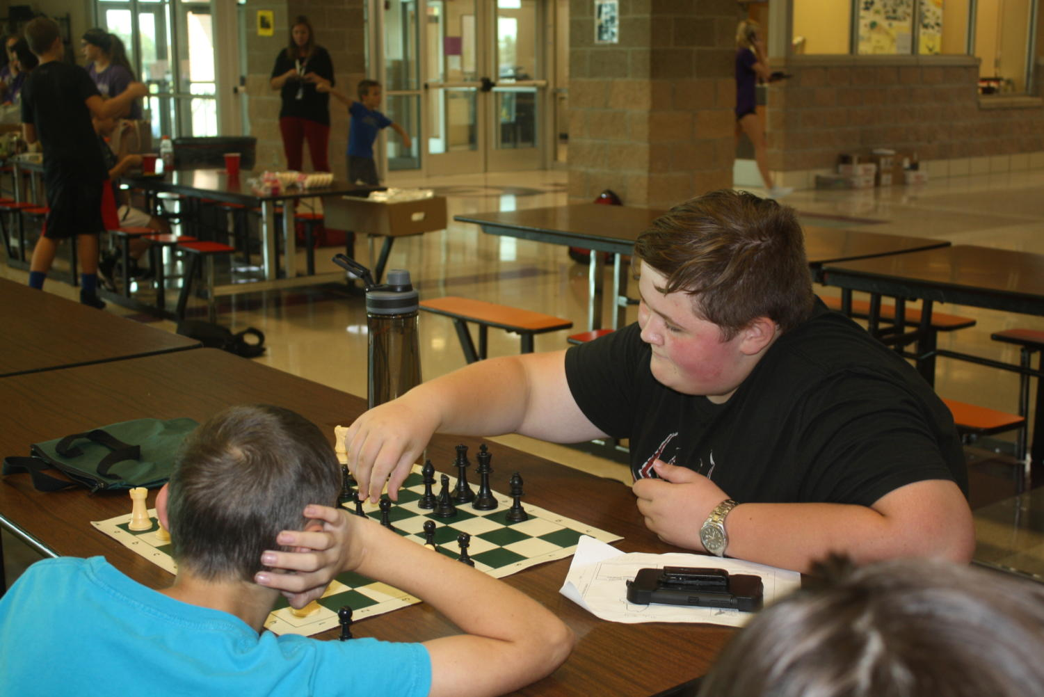 Students practice during a Chess Club meeting