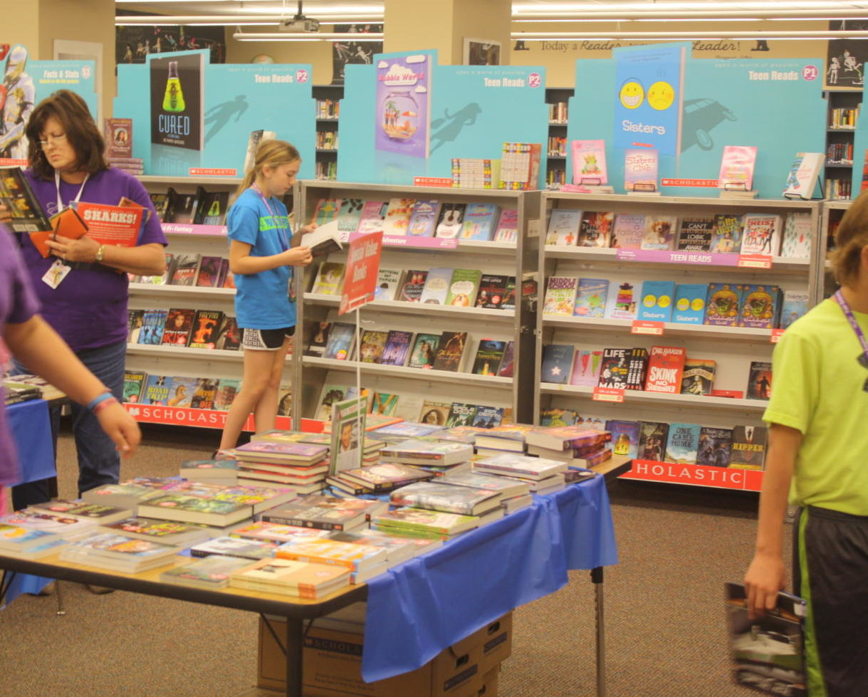 Middle school students enjoy the book fair (2014)
