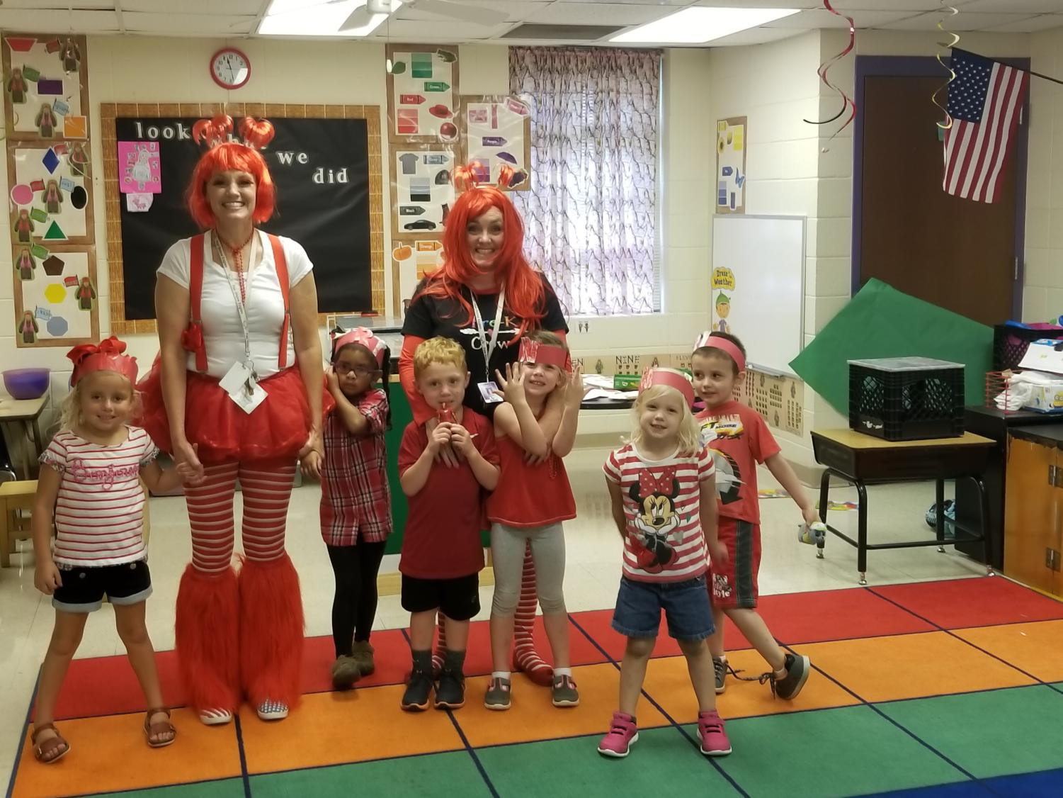 Mrs. Hill poses with some of her students on Red Day  Photo from the Fair Grove School website