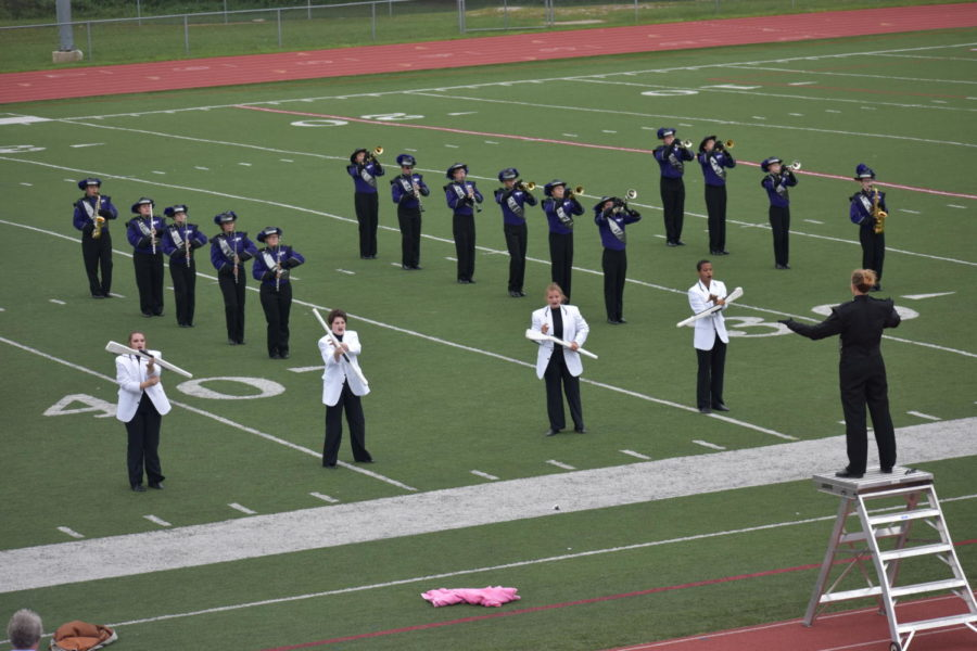 The+marching+band+performs+at+a+competition