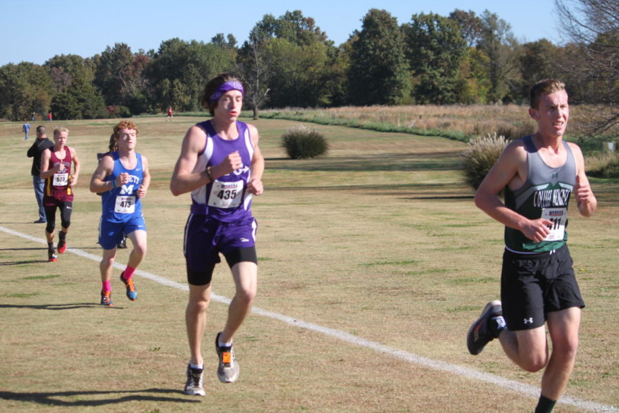 Ryan Odom (12) competes at cross country districts.