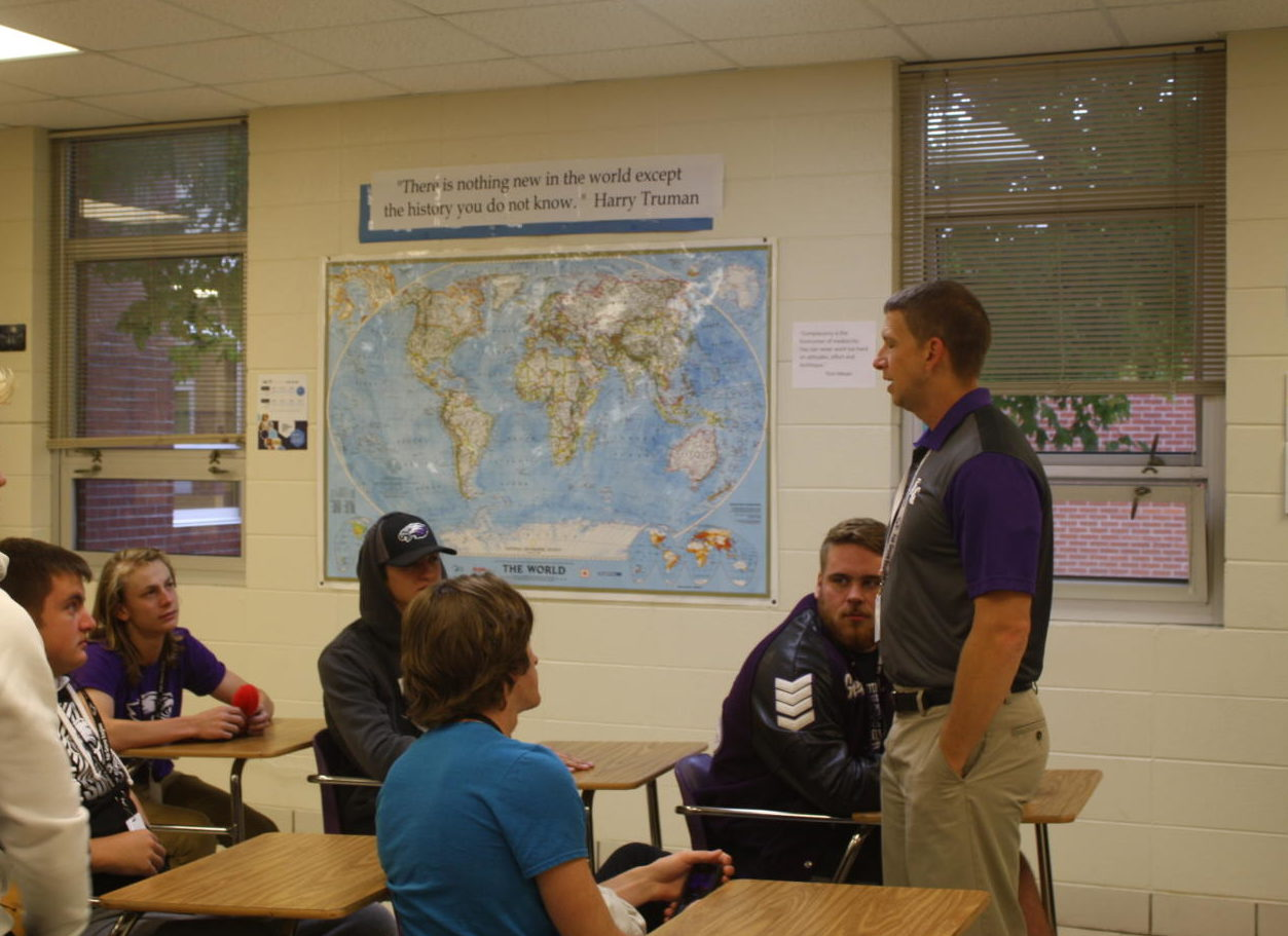 Mr. Carroll discusses with his students in an Advanced American History class