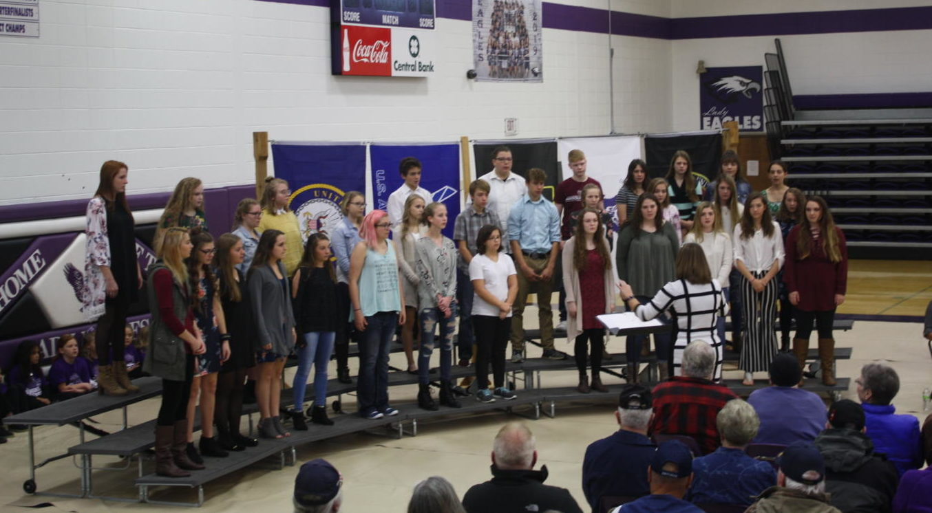 The high school choir performs at the Veteran's Day Assembly
