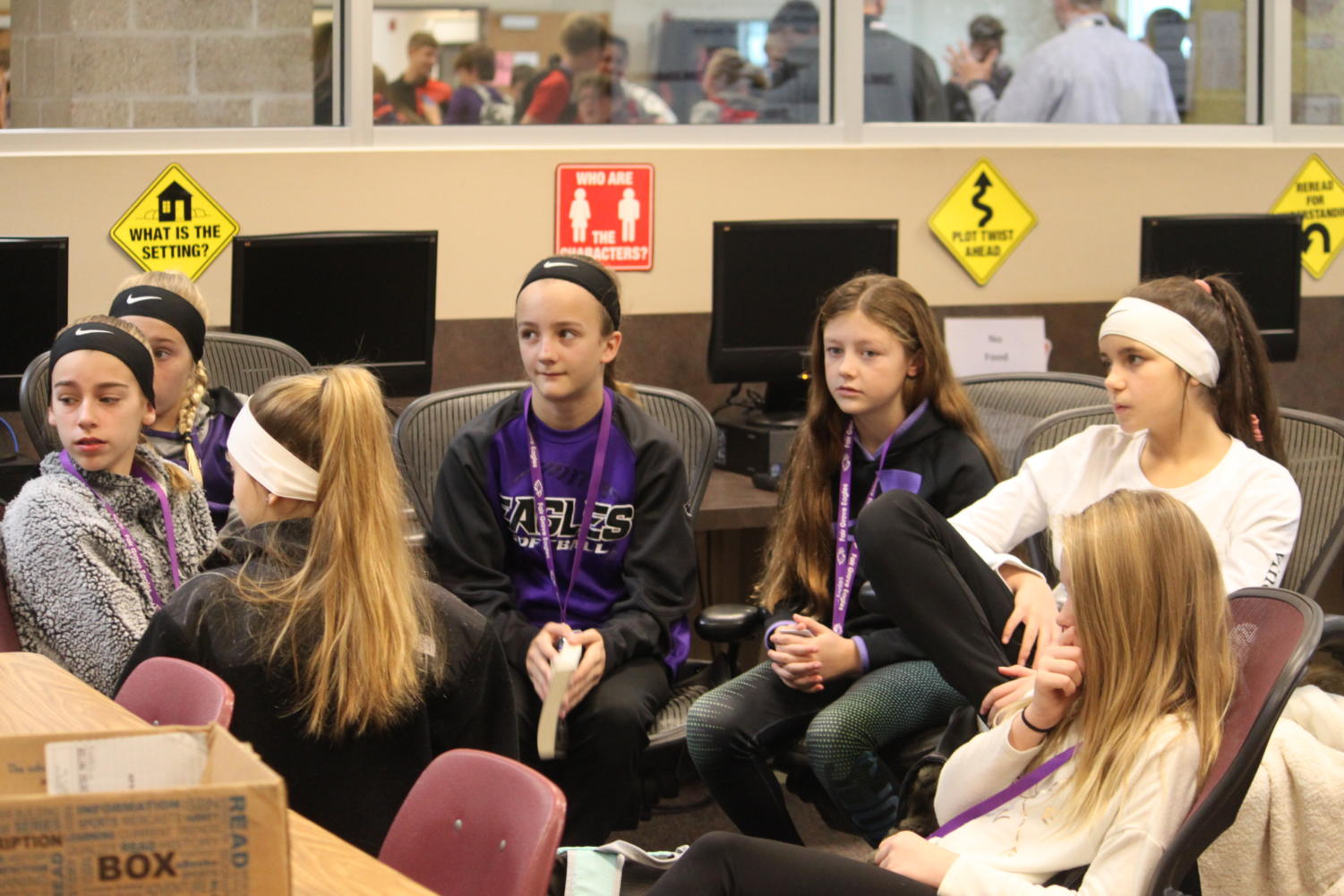 Middle school students listen during the TRUE meeting