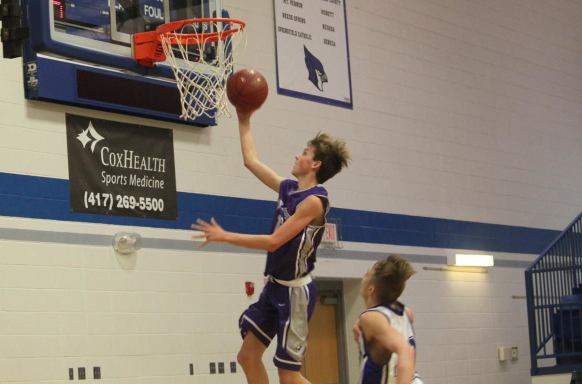 Tyler Padgett (9) goes up for a layup
