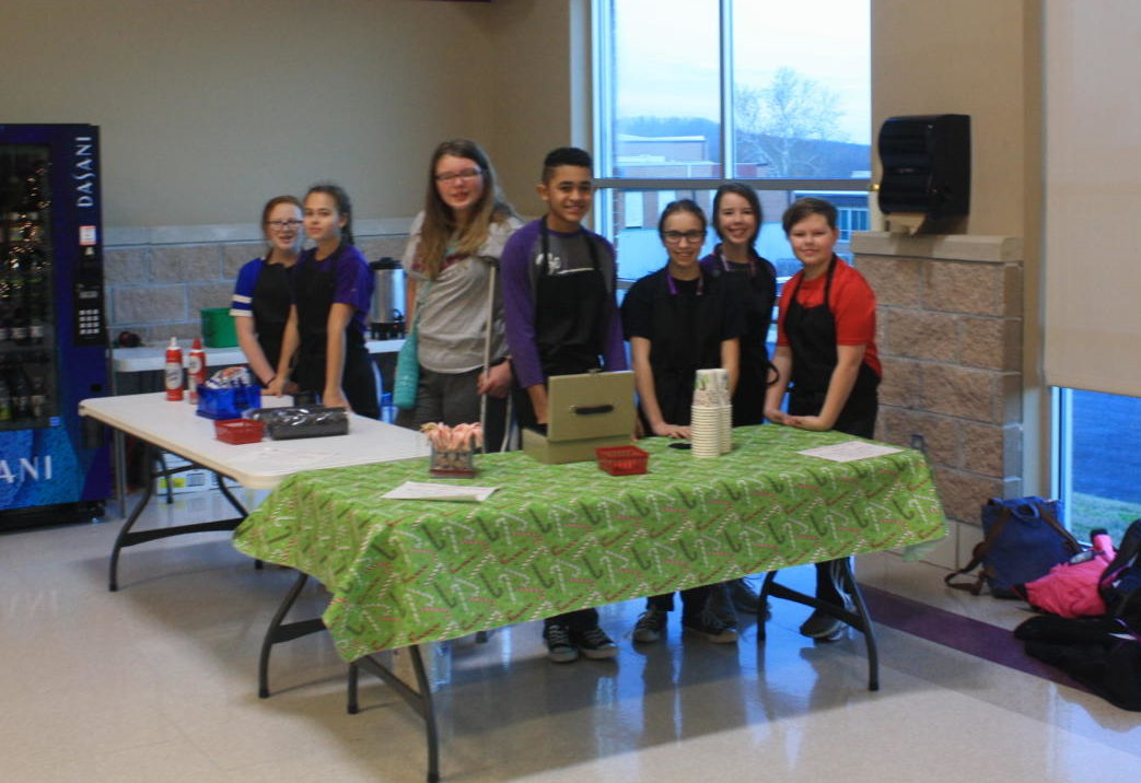 Middle school students work coffee shop for Character Council