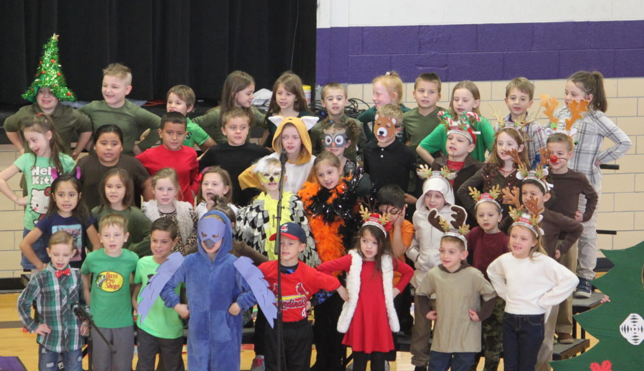 1st graders perform during their holiday program.