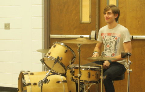 Mitch Van Cleave plays in the pep band at a home basketball game.