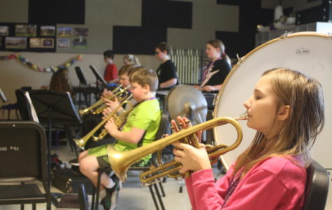 Sixth grade trumpet section practices their pieces for upcoming Spring Concert