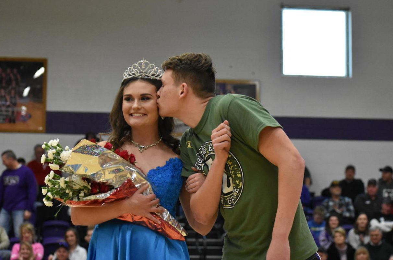 Courtwarming Queen, Senior Shannon Collins, receives a congratulatory kiss from her Senior escort Josh Thompson.