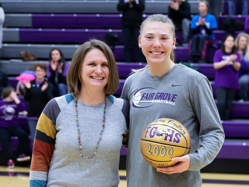 Coach Jenny Talbert poses with Alana Findley for her 2000th point. Photo provided by Cindy Hill