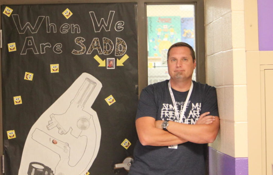 Foster poses in front of his door decorated for Teacher of the Month. FTA is reconsidering the award.