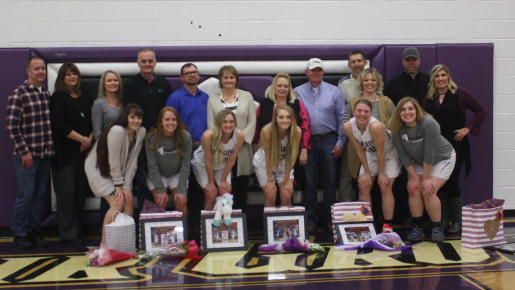 Girls Basketball Seniors pose on Senior Night