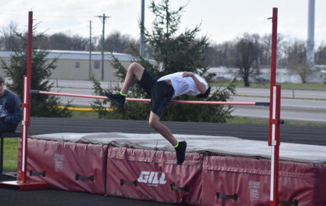 A Middle School track member participates in high jump.