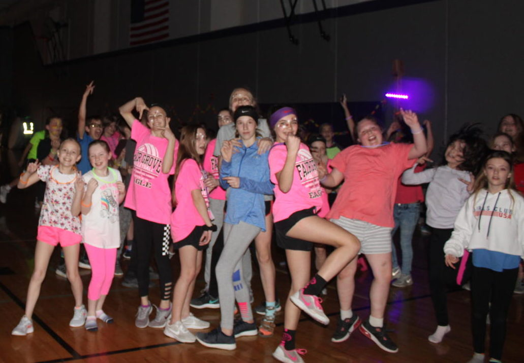 Middle Schoolers have fun at their dance.