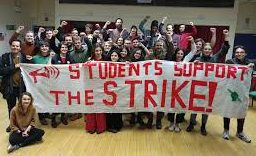FGHS students pose  with a poster in support of the strike, funnily it was taken on a cell phone.