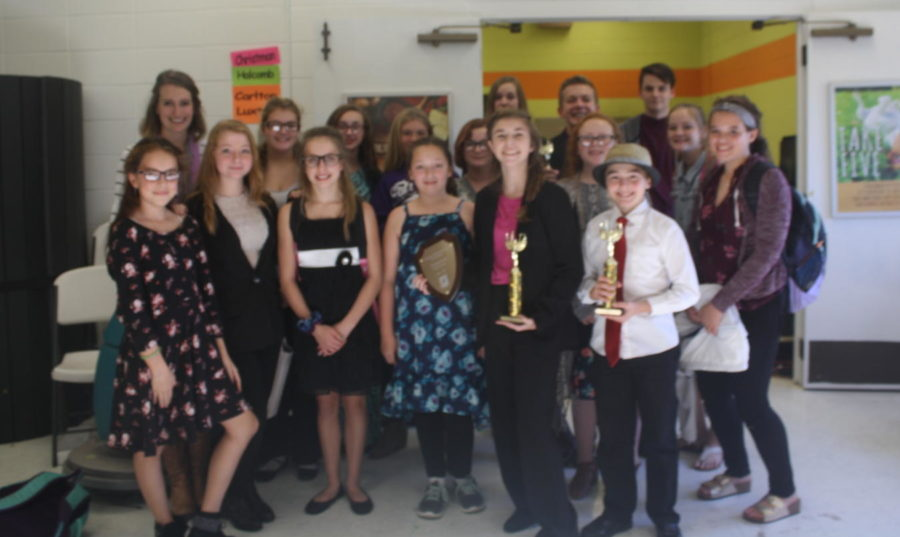 Middle+School+Speech+and+Debate+team+poses+with+their++trophies.