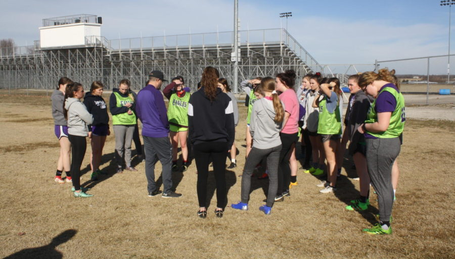 Coach+Florez+speaks+to+the+team+at+practice+before+the+District+game.