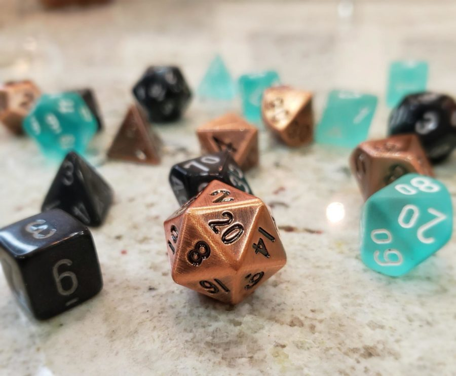 Sets of dice used to play Dungeons and Dragons, with the most iconic Dungeons and Dragons die,  20-sided dice.